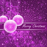 Pink xmas balls on purple. Christmas balls in translucent pink on purple sunburst background, snowflakes, bubbles, stars and snow Royalty Free Stock Photography