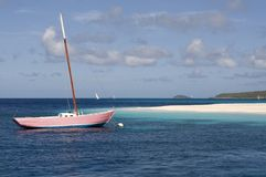 Pink Yacht - Palm Island View - Caribbean. Pink yacht moored off Palm Island with white coral sand, Caribbean ocean and distant islands in view. Near Union Royalty Free Stock Photos
