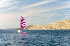 Pink yacht sailing near Croatia. Royalty Free Stock Photos