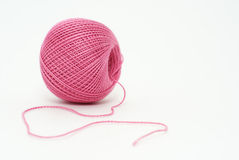 Pink yarn. Ball of pink cotton yarn isolated on white background stock photos