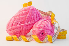 Pink yarn balls with measuring tape Stock Image