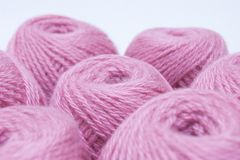 Pink yarn for knitting. Skeins of pink yarn for knitting Stock Image