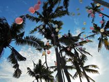 Pink and yellow balloons in the sky Stock Photography