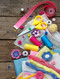 Pink, yellow and blue accessories for needlework on wooden background. Knitting, embroidery, sewing. Small business. Income from h Royalty Free Stock Image
