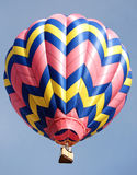 Pink yellow and blue balloon. Colorful hot air balloon against clear sky Royalty Free Stock Photography
