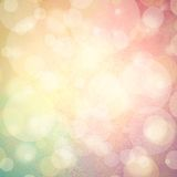 Pink yellow and blue green background with white bubbles or bokeh lights. Abstract colorful background, blurred bokeh lights on multicolored backdrop, floating Royalty Free Stock Photos