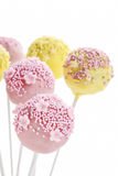 Pink and yellow cake pops isolated on white background Stock Photo