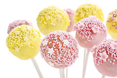 Pink and yellow cake pops isolated on white background Stock Image