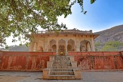Pink and yellow cenotaph with hill backdrop, Royal Gaitor, Jaipur, Rajasthan. Pink and yellow cenotaph with hill backdrop, at the Royal Gaitor, Jaipur, Rajasthan royalty free stock images