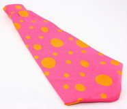Pink And Yellow Clown Tie. A brightly colored polka dot clown tie photographed on a white background. Great for everyday dress up and circus or Halloween fun Stock Images