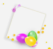 Pink, yellow and green easter eggs and small yellow flowers. on white background Royalty Free Stock Photos