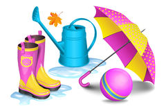 Pink-yellow gumboots in puddles, children umbrella, blue can. Pink-yellow gumboots in puddles, children umbrella, blue watering can, toy ball and maple leaf Royalty Free Stock Image