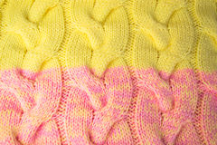 Pink and yellow knitted fabric background Stock Photography