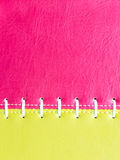 Pink and yellow  leather with white stitch Royalty Free Stock Photography
