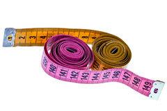 Pink and yellow measure tapes Stock Photography