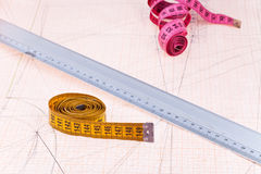 Pink and yellow measure tapes and metal ruler Stock Images