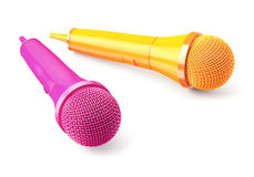 Pink and yellow microphones on blue background Stock Photo