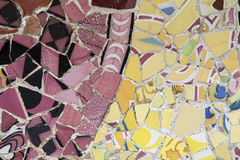 Pink and yellow mosaic. At Park Guell, Barcelona, Spain Royalty Free Stock Image