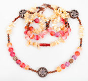Pink and yellow necklace from natural gemstones Stock Photos