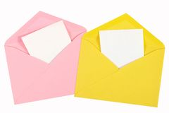 Pink and yellow open envelope with paper Isolated Stock Images