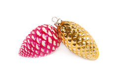 Pink and yellow pinecone ornaments Stock Photography