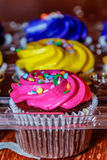 Pink, yellow and purple cupcakes ready for the party. Stock Photography