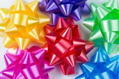 Multi-color gift wrap bows top close-up arranged in a circle stock images