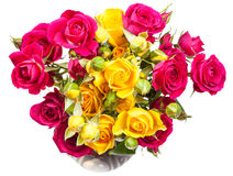 Pink and yellow rose spray flowers in vase Royalty Free Stock Images