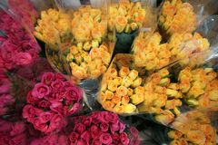 Pink and yellow roses in the market. Pink and yellow roses in the bouquet are ready for sale Stock Photography