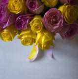 Pink and yellow roses and over white table. Valentines day background. stock photo