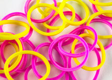 Pink and yellow rubber bands Stock Photos