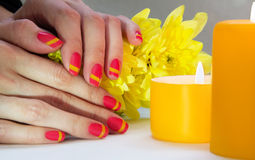 Pink and yellow striped nail art manicure Stock Photography