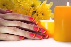 Pink and yellow striped nail art manicure Stock Image