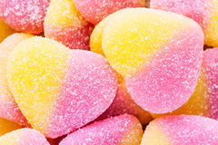 Pink and yellow sugar coated soft candies background, macro, top Royalty Free Stock Photos