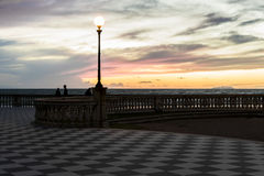 Pink and yellow sunset. Typical sunset on the terrace Mascagni in Leghorn Stock Image