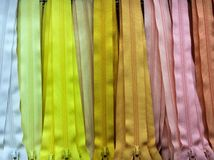 Pink and yellow tone zip background. Sewing zip colorful Royalty Free Stock Photo