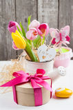 Pink yellow tulips on rustic wooden background Royalty Free Stock Images