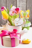 Pink yellow tulips on rustic wooden background Stock Images