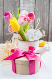 Pink yellow tulips on rustic wooden background Royalty Free Stock Photos