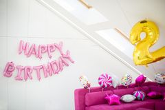 Pink, yellow and white balloons on a light background. Inscription Happy Birthday. Decor to celebrate the second birthday of the. Child royalty free stock photos