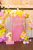 Pink, yellow and white balloons on a soft pink background. Inscription Happy Birthday stock photo