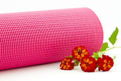 Pink yoga mat with colorful lantana flowers royalty free stock photography