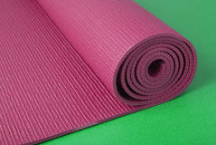Pink Yoga Mat on Green Royalty Free Stock Photo
