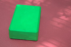 Pink yoga mat and green block Royalty Free Stock Photography