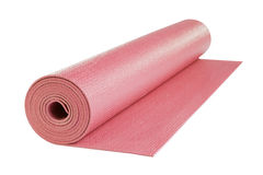 Pink yoga mat isolated, includes clipping path. Royalty Free Stock Photo