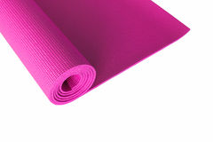 Pink yoga mat isolated on white. Stock Photography