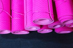 Pink yoga mats on the floor in a gym stock images