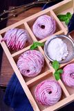 Pink zephyr covered in sugar powder in a wooden box. With cells royalty free stock image