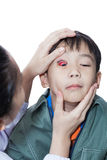 Pinkeye (conjunctivitis) infection on a boy, doctor check up eye Stock Photo