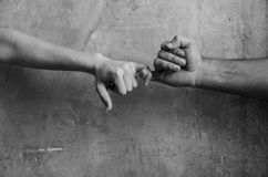 Male and female hands touching each other with little fingers stock image